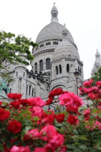 Basilica of Sacred Heart in Montmartre behind rose bushes